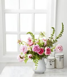 1. Start with Variety For a more interesting and colorful bouquet, select some flowers that have already bloomed and others that are just budding. 2. Prep Smart Clear a table or counter and group your flowers in loose piles so you can quickly pick up separate stems. Fill a vase two-thirds full with cool water. 3. Cut Right Using sharp scissors, trim stems as you go to avoid wilting (cut at a 45-degree angle so they get more water). To prevent mold, strip leaves that will sit in the ...