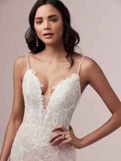 Laurette by Rebecca Ingram Delicate sheath wedding dress with an overlay of Chantilly lace and lace motifs. Plunging illusion V-neckline, illusion lace back, and beaded spaghetti straps complete the look. Lace Wedding Dress, Fit And Flare Wedding Dress, Bridal Dresses, Wedding Gowns, Lace Dress, Nude Gown, Blush Gown, Designer Gowns, Designer Wedding Dresses