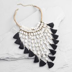 Our statement-making necklace is a tropical waterfall of style. Crafted of genuine seashells embellished with black cotton tassels cascading from bands of soft faux suede, it has a summery seaside look. Scarf Jewelry, Textile Jewelry, Shell Jewelry, Fabric Jewelry, Cute Jewelry, Diy Earrings, Diy Necklace, Necklace Designs, Fancy Jewellery