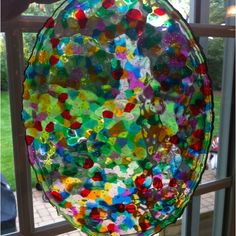 Melted plastic beads in the bottom of a baking dish at 400 for 20 minutes easy stained glass.