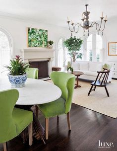 Easily accessible to the kitchen, the breakfast room's round dining table, which features a white marble top and a metal base, pairs with Verellen dining chairs upholstered in green Perennials indoor-outdoor fabric for durability. Dallas, Round Dining Table, Upholstered Dining Chairs, Custom Homes, Living Spaces, Living Rooms, Family Rooms, Interior Design, Home Decor