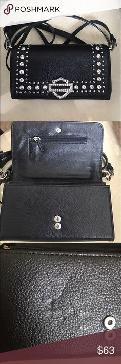 Harley Davidson Cross Body Wallet Never used!! This small jeweled Harley Davidson Leather cross body wallet has a snap on closure to secure your items. It includes 5 credit card slots and an ID slot. It has many compartments to organize your cash, checks, and coins. In the middle there is a zippered compartment that could be left open or closed. The strap is removable and adjustable to be converted from simply a wallet or a cross body. It does have one minor scuff as pictured Harley-Davidson…