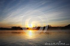 Photo about A colorful sunset over the water with mirror effect. Image of mirror, over, reflection - 49384441 Mirror Effect, Mists, Colorful, Celestial, Stock Photos, Sunset, Water, Photography, Outdoor