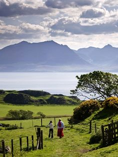 A mom & child heading out to look for fresh berries.   Isle of Arran, Scotland.