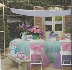 Aqua party decoration with all the tulle, aqua and pink