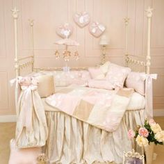 Exquisite silky fabrics, dimensional flowers, soft velvets and embroideries finished with luxurious satin ribbons. Made with beautiful taffeta crib skirt and designer diaper stacker.
