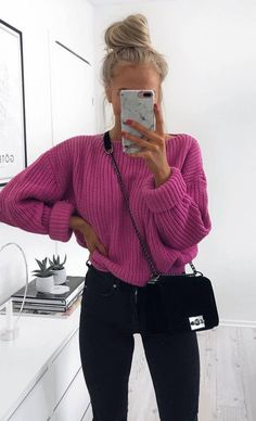 Fuchsia knit sweater with black jeans.