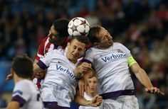 Atletico Madrid's Garcia fights to head ball with Austria Vienna's Mader and Ortlechner during their Champions League Group G soccer match a. La Champions League, Soccer Match, Soccer Ball, Austria, Madrid, Group, Sports, Champions League, Pictures
