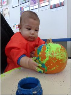 Painting a pumpkin is a great visual and sensory activity