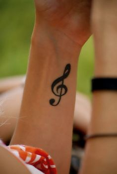 Treble Clef Tattoo. I have a friend this would be perfect for!