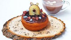 GROUNDHOG DAY DONUT - A cookie groundhog peeking out of a donut is a fun and creative breakfast treat.