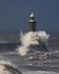 Google Image Result for http://images.wisegeek.com/lighthouse-with-stormy-seas.jpg