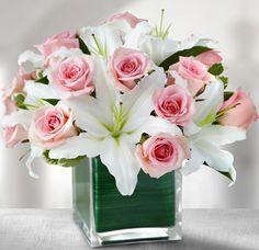 23.- Centros de Mesa con Lilies