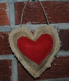 Rustic Burlap Heart - This easy-to-make hanging heart is a sewing machine project that combines regular felt fabric and some burlap.