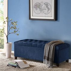 This modern storage ottoman accentuated with button tufting provides ample storage and features an elegant sand colored soft fabric with espresso legs.