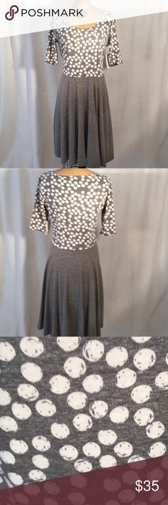 Dress Lularoe Nicole dress in grey and white, plain skirt with polka dot bodice, three quarter sleeves. 48% polyester, 36% cotton, 12% Rayon and 4% spandex. LuLaRoe Dresses Midi