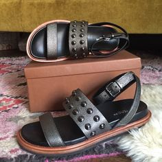 Coach sandals Brand new. In box. Never worn. Only tried on. Style 'Dannie' cross grain in gunmetal color. Ankle strap crosses in the back. So pretty and a bit edgy for summer! Purchased at Macy's. Coach Shoes Sandals