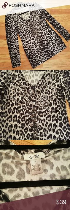 Cache top Adorable knit sweater by Cache. Black, gray and white with silver studs sprinkled throughout! NWOT! 97% Polyester and 3% spandex for slight stretch and perfect fit! Cache Tops Tunics
