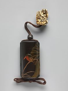 Case (Inrō) with Design of Lotus (obverse); Lotus and Bird (reverse) Artist: Shibata Zeshin (Japanese, 1807–1891) Period: Meiji period (1868–1912) Date: 19th century Culture: Japan Medium: Black lacquer with wood, shell, and glass inlays; Fastener (ojime): metal; Toggle (netsuke): carved ivory in the shape of a demon