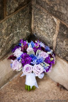 shades of purple and pops of blue in this bridal bouquet from wedding designed by Sparkling Events and Designs http://www.weddingchicks.com/vendor-guide/sparkling-events-designs