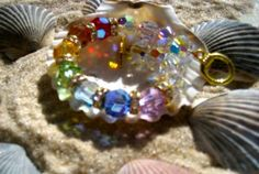 Wear these beautiful, sacred Swarovski, precision cut, lead crystal beaded bracelets to magnify your beauty, enhance your healing, and strengthen relationships.  All color comes from light and energy.  Refracted through a pure crystal or prism, the rainbow light creates a sequence of red, orange, yellow, green, blue, indigo, and purple filling your space with nature's positive energy, beauty and to balance your chakras and increase your vitality.