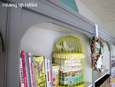 check out the painted bookcases -- cheapies from target, then added crown moldings and arches at the corners to make them fabulous.