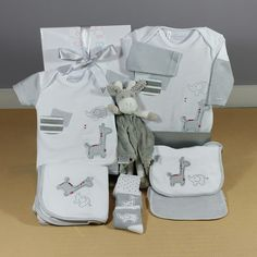 A great neutral baby gift. This safari design baby gift hamper is the perfect neutral baby gift. Baby Gift Hampers, Little Giraffe, Baby Wraps, Baby Socks, Long Sleeve Bodysuit, Baby Design, Corporate Gifts, Baby Bibs, Baby Shower Gifts