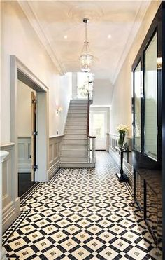 Perfect ceramic tiles for the floor in this grand, striking hallway. Love the gr… Perfect ceramic tiles for the floor in this grand, striking hallway. Love the grey panelled walls too. Hall Tiles, Tiled Hallway, Victorian Hallway Tiles, Victorian Stairs, Tile Entryway, Entry Tile, Edwardian Hallway, Tiled Staircase, Small Staircase