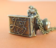 vintage+style+black+camera+locket+necklace+by+OneLoveLi+on+Etsy,+$5.99