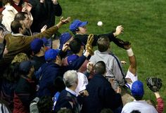 Heartbreaking, but look how many others were trying to catch it too!  On Oct. 14, 2003, 8th inning of Game 6 of the NL Championship Series, Steve Bartman, a devoted Chicago Cubs fan, reached for a foul ball getting in the way of Cubs LF Moises Alou, making the catch. The Cubs led Florida Marlins 3-2 in the series, and 3-0 in the game. 5 outs from their first World Series since 1945. Afterward, of course, everything went to shit. Bartman had to be escorted from Wrigley. He's never been back.