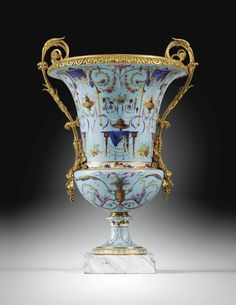A pair of gilt-bronze-mounted Sèvres soft-paste porcelain `Vases Medici', almost certainly supplied by the marchand-mercier Dominique Daguerre, the mounts attributed to Pierre-Philippe Thomire (1751-1843) Louis XVI, circa 1788-1790  superbly painted on a pale blue ground with 'rich arabesques' including, on the upper part, draped tables supporting steaming brûle-parfums alternating with others hanging from draped baldaquins