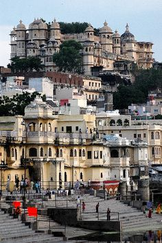 UDAIPUR, INDIA:  The City Palace sits above the Bagore-ki-Haveli (bottom left, yellow), former home of the Mewari prime minister.