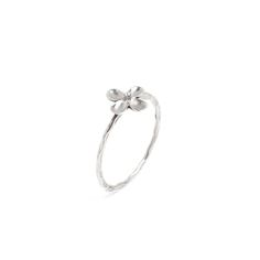 Dress up your digits with a set of three stackable rings. Each delicate ring is composed of hammered sterling silver with a dainty flower.  Find it on Splendor Designs