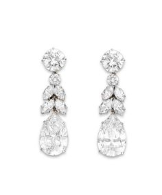 A PAIR OF DIAMOND EAR PENDANTS, BY HARRY WINSTON   Each suspending a pear-shaped diamond, weighing approximately 6.67 and 7.78 carats, to the marquise and circular-cut diamond foliate line and circular-cut diamond surmount, weighing approximately 2.51 and 2.63 carats, mounted in platinum, circa 1976, in a Harry Winston black suede pouch  With maker's mark for Harry Winston