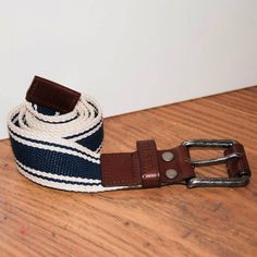 Men's canvas belt, the perfect accessory this summer for your chinos and shortsAvailable in medium or largeMen's canvas belt, navy / white Navy and white striped design with genuine leather trim details Genuine leather buckle Available in medium (to fit UK waist size 30 -34) or large (to fit UK waist size 36-38) The perfect accessory for your chinos and shorts this summer Other mens accessories and fashion peices launching this AutumnGenuine Leather Available in medium (to fit UK waist size…