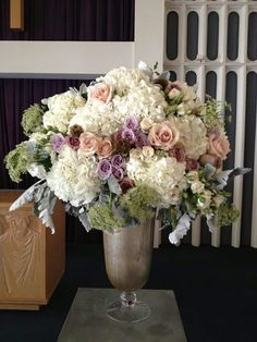 Roses and feverfew in urn table arrangements pinterest flower roses and feverfew in urn table arrangements pinterest flower company diy wedding and florists mightylinksfo