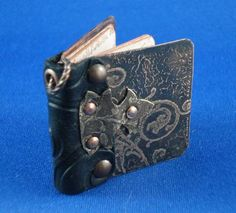 Handmade mini book by Onyxnox on #craftster. So cool! Another mini book for the new year - JEWELRY AND TRINKETS