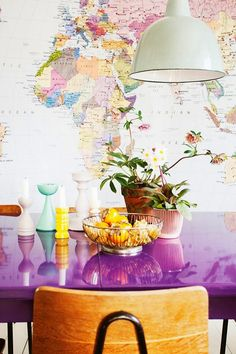 electric purple table and world map wall paper <3