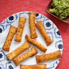 Tequeños with Guacamole | Food & Wine. Wonton wrappers filled with guacamole and fried