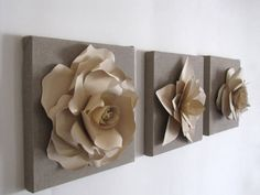 set of three canvas frames with paper flowers