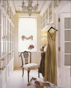Dressing hall w/ full-size door knobs and white/glass cabinets; Alessandra Branca