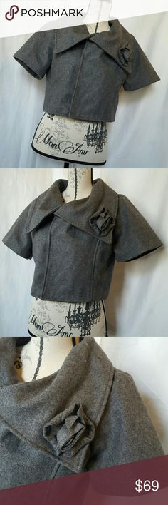 👄 NWOT Stunning Wool Shrug 👄NWOT 5 snap closure, lining: 100% polyester. Body: 68% wool 17% polyester 15% Nylon.  Stunning collar.  Short sleeve.  Bought in a High End boutique in Park City Utah.   Please ask any and all questions before purchasing this item.  🚭SMOKE FREE HOME Boutique  Jackets & Coats