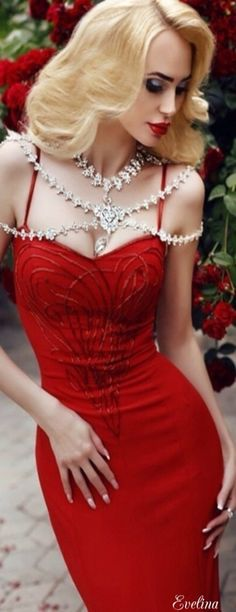 Diamond drapery couture. Not just over the shoulder but over-the-top! Necklaces to die for.