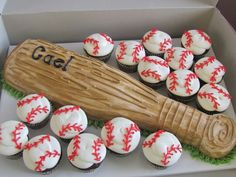 Baseball bat cake and baseball cupcakes. Cute! Just a pix but awesome