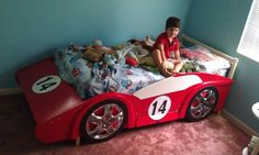 What boy wouldn't love this race car bed?