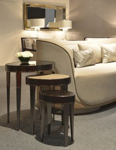 New Kos Nesting tables with tops in 3 different finishes: grey mirror, leather and Ebony veneer. Black nickel legs and trims