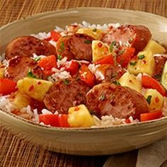 Hawaiian Pineapple Sweet & Sour Smoked Sausage — Sauteed smoked sausage, red bell pepper, and fresh pineapple with sweet chili garlic sauce are served over hot cooked rice.