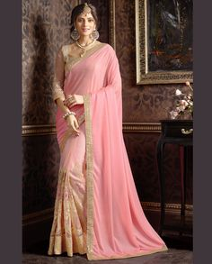 baby pink half and half sari with golden embellished broad border   1. Baby pink art silk net embroidered half and half sari2. Zari, resham embroidery, embroidery butta with stone work and lace border2. Comes with matching unstitched blouse3. Can be stitched up to size 40 inches