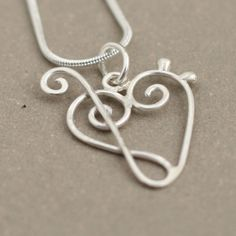 music jewelry. MINI Love of Music necklace heart. treble clef and bass clef. sterling silver music heart pendant.. $39.00, via Etsy.