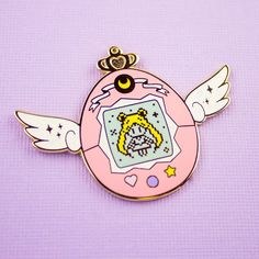 Congratulations, you're now the owner of a very special Sailor Pet!The Sailor Moon inspired tamagotchi collection features glitter accents in the wings and egg decals and is the perfect travel size. This lil' pin is perfect for any Moonie! Grab a full inner senshi pets setOr a full outer senshi pets setAnd if you're fe